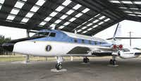 A Lockheed JetStar aircraft used by Lyndon Johnson during his years as vice president and then as president, is parked in a hangar.