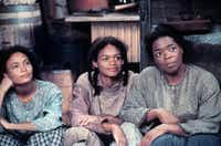 """""""Beloved,"""" with Thandie Newton (left), Kimberly Elise and Oprah Winfrey, illustrates slavery's violence upon the human body"""