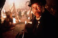 Morgan Freeman in Amistad (1997), about a 1839 mutiny aboard a slave ship that is traveling towards the northeastern coast of America. Much of the story involves a court-room drama about the free man who led the revolt.