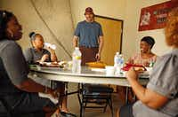 Pecan Lodge owner and pitmaster Justin Fourton visits with Mesquite diners (from left) Latoyha Lea, LaKisha Griffin, Khristy Love and Tamara Love at his Farmers Market restaurant.