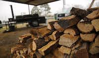 Pit Boss and owner Terry Massey uses mostly pecan in his smoker but on occasion will use oak at Lazy S&M BBQ in Joshua.Tom Fox  -  Staff Photographer