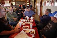 Texas BBQ Posse members (from left) Jim Rossman, Gary Jacobson, Daniel Goncalves, Chris Wilkins, Michael Meadows and Phil Lamb chat after tasting the smoked meats at Pit Stop BBQ in Waxahachie.Tom Fox  -  Staff Photographer