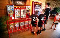Kids have fun playing with the digital jukebox at Pit Stop BBQ.Tom Fox  -  Staff Photographer