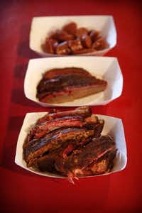 Bowls full of smoked ribs (bottom), brisket, and sausage at Pit Stop BBQTom Fox  -  Staff Photographer