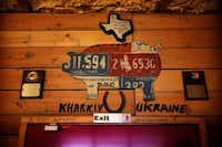 A host of BBQ competition trophies won by pitmaster and owner Steve Graham are seen above the front door at Pit Stop BBQ.Tom Fox  -  Staff Photographer