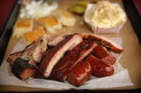 The Texas BBQ Posse recently headed south of D-FW for a delicious tour of several barbecue joints, all just a stone's throw from D-FW. Scroll through the gallery to see all the spots they hit. Pictued: smoked brisket, burnt ends, ribs and sausage at BBQ on the Brazos in Cresson.Tom Fox  -  Staff Photographer