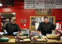 BBQ on the Brazos pitmaster John Sanford, left, and Michael Warren chat up customers in line at their restaurant off of I-35 in Cresson.Tom Fox  -  Staff Photographer