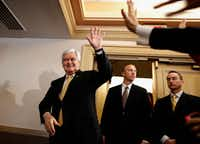 Claiming a lead in some statewide polls, Newt Gingrich arrives for a campaign rally in Jacksonville, Fla., on Monday.