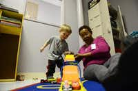 Catherine Wright, child specialist, plays with Jaxon Kendall, 2, while his mother, Sara, attends the new Pregnant and Post-Partum Prevention and Intervention program offered by Nexus Recovery Center. 252(Rose Baca - neighborsgo staff photographer)