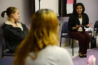 Lesley Bonner, a behavioral intervention specialist from AIDS Arms, talks to Sara Kendall (left) and Tracy Germait at Nexus Recovery Center.(Rose Baca - neighborsgo staff photographer)