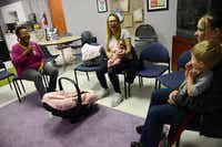 Child specialist Catherine Wright (right) talks to Tracy Germait (middle), Sara Kendall and her son, Jaxon, 2, during the new Pregnant and Post-Partum Prevention and Intervention program at Nexus Recovery Center. The 10-week program focuses on the parent and child relationship, allowing the clients to bring their children with them.Rose Baca - neighborsgo staff photographer