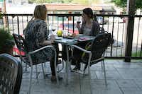 Noël Crotty (left) and Hannah Moore enjoy drinks on the patio at Times Ten Cellars in Lakewood. Times Ten co-founder Kert Platner is involved with the Live Local East Dallas campaign.( Staff photo by ANANDA BOARDMAN  -  neighborsgo )