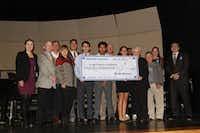 Northrop Grumman presents a check to Irving ISD. (Irving ISD Photo)