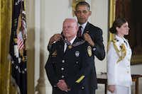 President Barack Obama presented the Medal of Valor to Garland police Officer Gregory Stevens during a ceremony in the East Room of the White House on Monday. (Evan Vucci/The Associated Press)