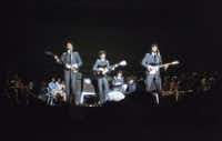 The Beatles perform at Carnegie Hall on Feb. 12, 1964. Sid Bernstein, the music promoter who brought the Beatles to American and was responsible for the Carnegie Hall concert, died Aug. 21, 2013. He was 95.