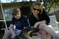 "Lisa Buchanan and her son, Conner, 15, take a break after walking their dog, Trixie, together in Plano on Friday, March 25, 2011. Conner who was diagnosed with OCD at age 8, but says now, ""I'm clean,"" feels that physical exercise helps relieve his anxiety."