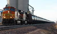 FILE - In this Nov. 6, 2013, file photo, a BNSF Railway train hauls crude oil near Wolf Point, Mont. With potentially-explosive shipments increasing 40-fold in recent years as North American crude production booms, the railroad industry, at the urging of the Obama administration and safety officials in the U.S. and Canada, is considering a closer look at the risks posed by trains that now carry hazardous liquids through every region of the country. (AP Photo/Matthew Brown, File)Matthew Brown - AP