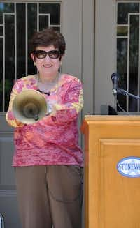 Stonewall Jackson Elementary's former principal, Olivia Henderson, rings the school bell for the last time at the year-end flag ceremony June 11.( SUBMITTED PHOTO 219,4,200  )