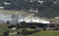 Smoke rises from a neighborhood following Wednesday's explosion in West, Texas.