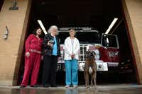 Highlands Meadows Neighborhood Association Petwatch members (from left) Clarice Jackson, Joyce Ferguson and Pat Teater stand with Hula, a live find disaster dog, at Fire Station No. 48 in Lake Highlands on March 26Rose Baca - neighborsgo staff photographer