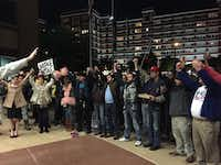 """A crowd sings """"We Shall Overcome"""" outside the Dallas Jack Evans Police Headquarters in November during a rally after a spate of attacks and robberies in the Oak Lawn neighborhood."""