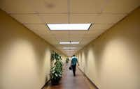 Michael Gonzales walks down an underground tunnel in the Bank Tower.ROSE BACA - neighborsgo staff photographer
