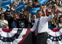 President Barack Obama and Vice President Joe Biden greeted each other on stage during a joint campaign event at Triangle Park in Dayton, Ohio, Tuesday.
