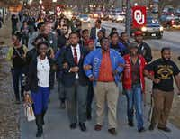 OU students  marched to the now-closed Sigma Alpha Epsilon fraternity house during a rally Tuesday.(Sue Ogrocki - The Associated Press)