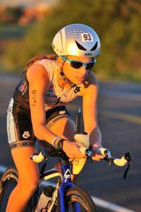 Ariana races through the bike leg of the Spring Fall Classic Triathlon in April. Ariana, 13, placed first among females 24 and younger at the race.(Photo submitted by ALLANA LUTERMAN)