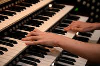 Brian Hataway, 20, who was diagnosed with autism, plays the organ at First Baptist Church in Garland.Rose Baca  -  neighborsgo staff photographer
