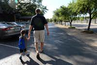 Robert Griffin walks with his son Donovan, 3, to the Brookhaven Country Club, which sits in the center of the neighborhood and includes three golf courses, a pool and tennis courts. The neighborhood was found to be the best overall area to live in Carrollton, Farmers Branch and Addison, according to a data analysis by The Dallas Morning News.