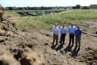 Hines Interests representatives (from left) Curtis Attaway, Ben Brewer, Rob Witte and Danny Opitz stand at the construction site of the firm's new housing development adjacent to Hackberry Creek, which has become a model  for single-family developments. The neighborhood was found to be the best overall area to live in the Irving and Coppell areas, according to a data analysis by The Dallas Morning News.