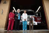 Highland Meadows Neighborhood Association Petwatch members (from left) Clarice Jackson, Joyce Ferguson and Pat Teater stand with Hula, a live find disaster dog, at Fire Station No. 48 in Lake Highlands. The Petwatch group donated animal oxygen masks to the fire station, and now the group has launched an initiative to equip all 57 Dallas fire stations with at least one - if not two - sets of pet oxygen masks.Rose Baca - neighborsgo staff photographer