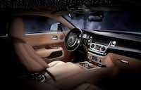 "The 2015 Rolls-Royce Wraith  includes a $5,900 option that allows you to drive under ""stars"" that glow from holes in the headliner fitted with tiny LED lights.(Rolls-Royce)"