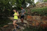 Ashley Agan and her husband, Chris Marr, exercise on hillside stairs that were part of a $2.1 million project to restore and update elaborate stonework built in the 1930s by Works Progress Administration crews at Reverchon Park in Dallas.Michael Ainsworth - Staff Photographer