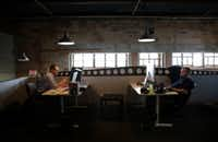 Matt Tschoegl (left) and Logan Fisher, full-stack developers for ParkHub, work at the company's Deep Ellum office. (Rose Baca/The Dallas Morning News)