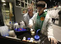 Jost Flender, left, and Caiden Trivedi, 9, of Switzerland learn about DNA while doing an experiment in the Biolab at the Perot Museum of Nature and Science.( Michael Ainsworth  -  Staff Photographer )
