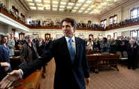 Gov. Rick Perry entered the House of Representatives chambers for his 2003 State of the State address.