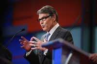 Republican presidential candidate Rick Perry fields a question during a presidential forum hosted by FOX News and Facebook at the Quicken Loans Arena August 6, 2015 in Cleveland, OH. (Photo by Scott Olson/Getty Images)