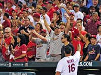 The St. Louis Cardinals' Kolten Wong soaks in the love from fans during a game at Busch Stadium. Wong isn't the fans' only favorite: The Cardinals ranked first in the major leagues in the 2015 Sports Fan Loyalty Index released Monday.( File 2014  -  Getty Images )