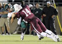 Garland Naaman Forest quarterback Justin Walker (9) laid out by Plano Senior High David Griffith (14) during the game's second quarter on Sept. 20 in Plano. Plano won 35-7. The team will play Hebron at 7:30 p.m. on Friday.