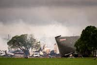 The remains of the the West Fertilizer Co. plant smolder in the rain in West, Texas.Smiley N. Pool - AP
