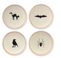 BITE-SIZE: Hand-painted appetizer plates add a festive touch without going overboard. Set of four, $29.95. Williams-Sonoma stores or www.williams-sonoma.com.