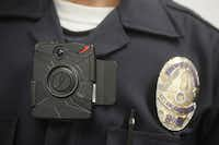A Los Angeles Police officer wears an on-body camera during a demonstration.( Damian Dovarganes  -  AP )