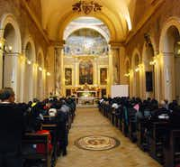 Mass is underway on a Sunday morning at Santa Pudenziana church in Rome, which these days has a large Philippino congregation. The fresco in the apse is thought to be the oldest surviving Christian fresco in Rome.