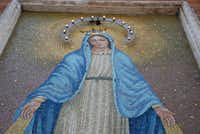 You need not even enter a church in Rome to discover beautiful religious art. This mosaic of the Virgin Mary is on the side of a church in the Moni district.