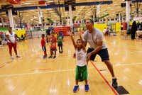 Volunteer coach Terry Scott helps Ryan Ung, 5, take a practice shot at Plano Sports Authority, a nonprofit that provides year-round recreational sports leagues to boys and girls in Plano ISD and surrounding areas. PSA opened its third campus on Murphy's planned Central Park in October. It is now looking at opening a fourth location in McKinney.ROSE BACA