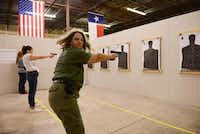 Brenda Newby of Seagoville shoots a round of non-lethal ammunition during a women's self-defense class at Patriot Protection in Plano. The facility opened in September and provides defensive firearms and tactics training.(ROSE BACA)