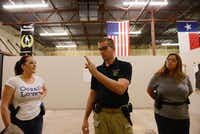 Tim Dodd, owner, helps instruct Leigh Fitzgerald (left) and Thy Dam during a women's self-defense class at Patriot Protection in Plano.(ROSE BACA)