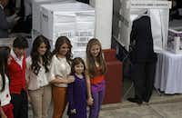 While Enrique Peña Nieto marked his ballot in this month's election, his children posed for photos.